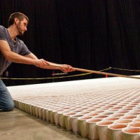 A huge mosaic picture composed of 66,000 paper cups with coloured water